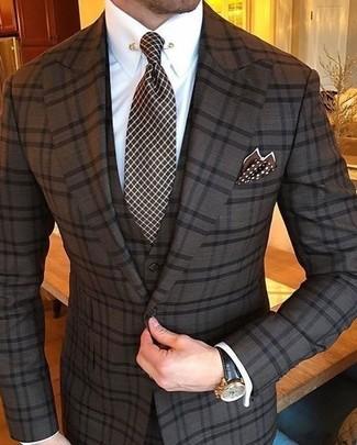 How to wear: dark brown polka dot pocket square, dark brown check tie, white dress shirt, dark brown check three piece suit