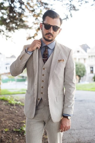 How to wear: beige pocket square, multi colored floral tie, blue chambray dress shirt, beige seersucker three piece suit