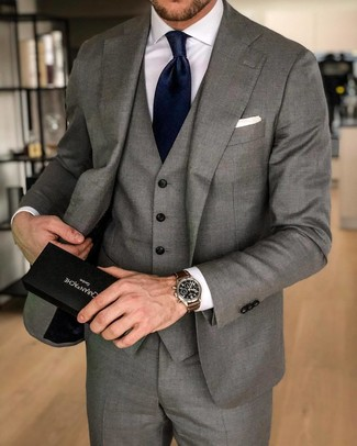 How to wear: white pocket square, navy silk tie, white dress shirt, grey three piece suit
