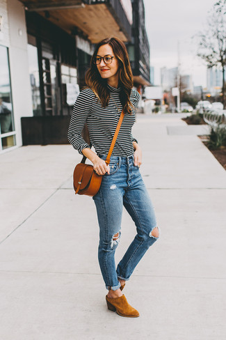 How to wear: tobacco leather crossbody bag, tobacco suede ankle boots, blue ripped skinny jeans, black and white horizontal striped turtleneck