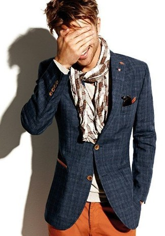 How to wear: beige plaid scarf, tobacco chinos, beige long sleeve t-shirt, navy plaid blazer