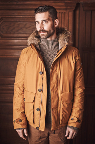 How to wear: tobacco chinos, brown knit turtleneck, orange parka