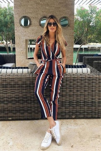How to wear: black sunglasses, tobacco leather crossbody bag, white canvas espadrilles, multi colored vertical striped jumpsuit