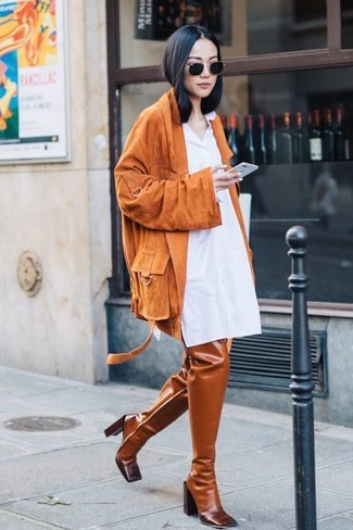 How to wear: black sunglasses, tobacco leather over the knee boots, white shirtdress, orange suede biker jacket