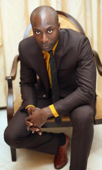 How to wear: dark brown vertical striped tie, tobacco leather oxford shoes, orange dress shirt, dark brown suit