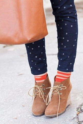 How to wear: orange horizontal striped socks, tobacco leather tote bag, tan suede wedge ankle boots, navy polka dot skinny jeans