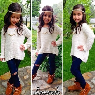 How to Wear Brown Uggs For Girls: Consider dressing your little fashionista in a white sweater with navy jeans for a beautiful casual get-up. Brown uggs are a nice choice to finish off this style.
