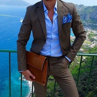 How to wear: blue pocket square, tobacco leather zip pouch, blue dress shirt, dark brown suit