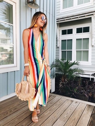 How to wear: silver sunglasses, tan straw tote bag, tan leather flat sandals, multi colored vertical striped maxi dress