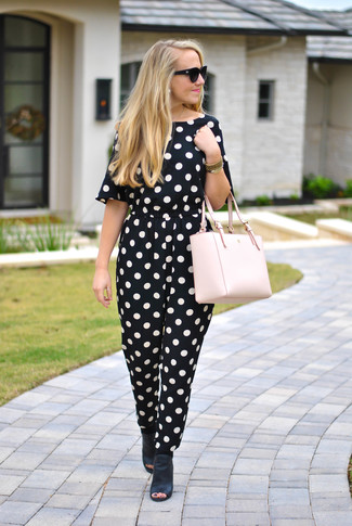 How to Wear a Pink Leather Tote Bag: Pair a black and white polka dot jumpsuit with a pink leather tote bag, if you appreciate comfort dressing without looking like a hobo to look cool. A cool pair of black leather mules is the simplest way to add an added dose of chic to your ensemble.