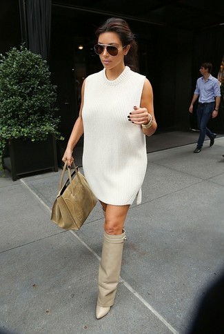 How to Wear a White Sweater Dress: Go for a white sweater dress for a laid-back and stylish look. The whole look comes together when you round off with beige leather over the knee boots.