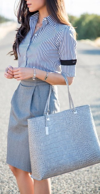 How to wear: silver bracelet, grey snake leather tote bag, grey pencil skirt, white and navy vertical striped dress shirt