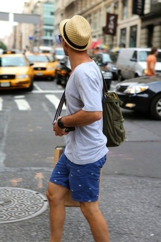 How to wear: tan straw hat, olive canvas tote bag, blue print shorts, grey v-neck t-shirt
