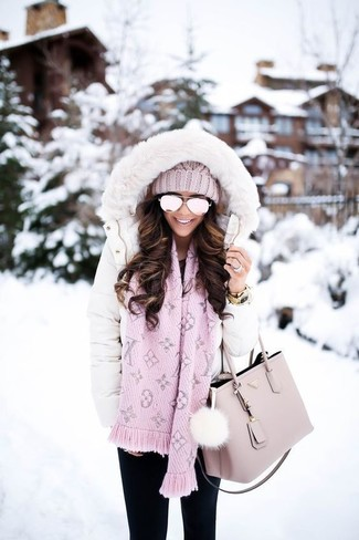 How to wear: pink knit beanie, pink leather tote bag, black skinny jeans, white puffer coat