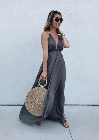 How to wear: dark brown sunglasses, tan straw tote bag, tan leather thong sandals, charcoal maxi dress