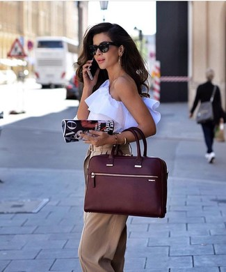 How to wear: black sunglasses, burgundy leather tote bag, tan wide leg pants, white ruffle sleeveless top