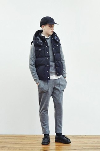 How to Wear a Navy Gilet For Men: For a neat and relaxed ensemble, rock a navy gilet with a white long sleeve shirt — these two pieces work really great together. When not sure about the footwear, complement your outfit with a pair of black leather desert boots.