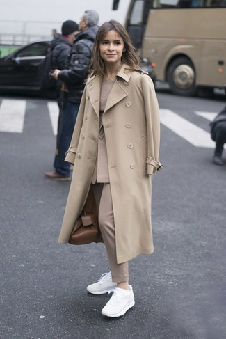 Miroslava Duma wearing Beige Trenchcoat, Beige Blazer, Beige Crew-neck Sweater, Beige Dress Pants