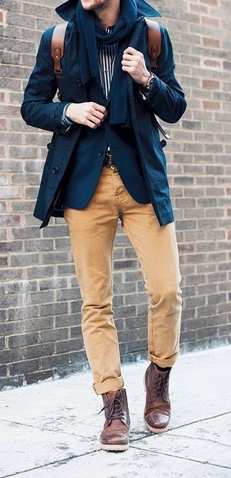 This combo of a trench and camel chinos is hard proof that a safe look doesn't have to be boring. Dark brown leather casual boots work spectacularly well here. When it comes to dressing for summer-to-fall weather, nothing beats a killer getup that will keep you warm and looking your best.