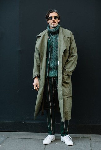 This combination of a trenchcoat and dark green vertical striped dress pants oozes masculinity and refined elegance. For a more relaxed take, grab a pair of white leather low top sneakers. As days are getting cooler, you'll see that an ensemble like this is great for the season.