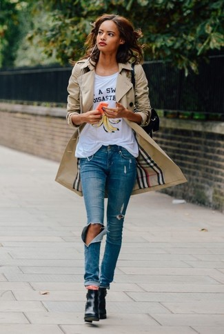 Women's Tan Trenchcoat, White Print Crew-neck T-shirt, Blue Ripped Skinny Jeans, Black Leather Ankle Boots