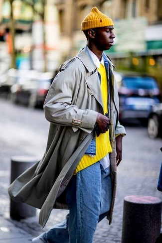 You'll be surprised at how easy it is to get dressed like this. Just a trenchcoat teamed with blue jeans. Mix things up by wearing white leather low top sneakers. When it's one of those gloomy fall days, what better to brighten things up than a dapper outfit like this one?