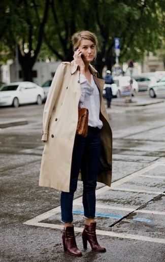Women's Beige Trenchcoat, White Dress Shirt, Navy Jeans, Burgundy Leather Ankle Boots