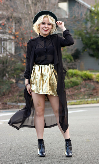 How to wear: black linen trenchcoat, black chiffon dress shirt, gold skater skirt, black leather ankle boots
