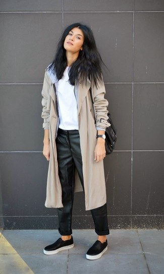 Nail glam in a grey trenchcoat and black leather pajama pants. Dress down your look with black leather slip-on sneakers.
