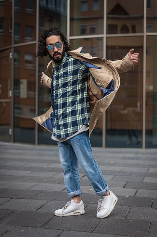 How to wear: tan trenchcoat, navy plaid long sleeve shirt, blue jeans, white athletic shoes