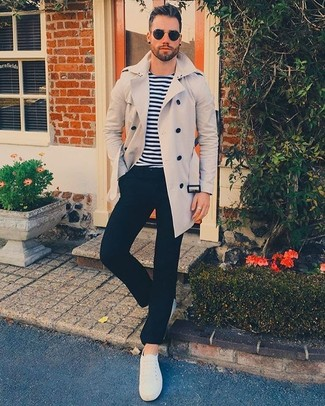 A trenchcoat and black dress pants will showcase your sartorial self. For footwear go down the casual route with white canvas low top sneakers. This is a fail-safe option for a neat winter-to-spring outfit.