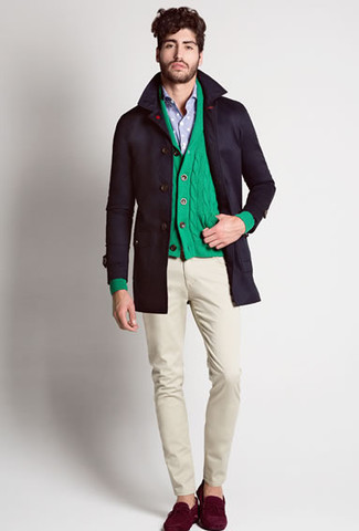 How to wear: black trenchcoat, green shawl cardigan, light blue long sleeve shirt, beige chinos