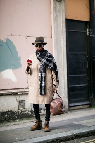 How to wear: tan trenchcoat, black skinny jeans, tobacco suede casual boots, brown leather holdall