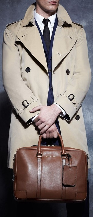 How to wear: beige trenchcoat, navy suit, white dress shirt, brown leather duffle bag