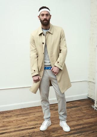 How to wear: tan trenchcoat, grey sweatshirt, blue print crew-neck t-shirt, grey sweatpants