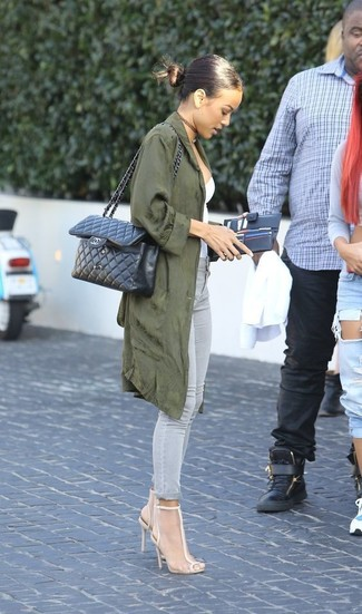 A Stella McCartney Oversized Trench Coat and grey skinny jeans is a nice pairing to impress your crush on a date night. This getup is complemented perfectly with beige mesh heeled sandals. A good illustration of transitional style, this outfit is an essential when spring comes.
