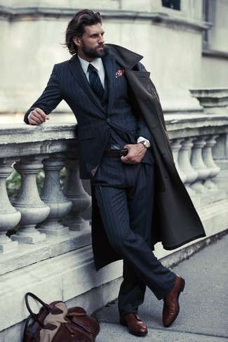 A modern man's sophisticated closet should always include such stylish essentials as a trench and a navy blue vertical striped three piece suit. For a more relaxed take, make dark brown leather derby shoes your footwear choice. If you feel uninspired by your transitional season fashion options, this getup just might be the inspiration you are searching for.