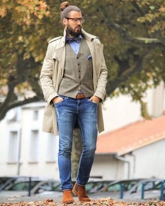 How to wear: beige trenchcoat, tan waistcoat, light blue dress shirt, blue skinny jeans