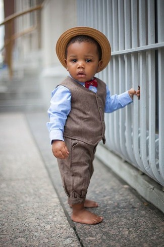 How to wear: tan straw hat, brown trousers, light blue long sleeve shirt, brown waistcoat
