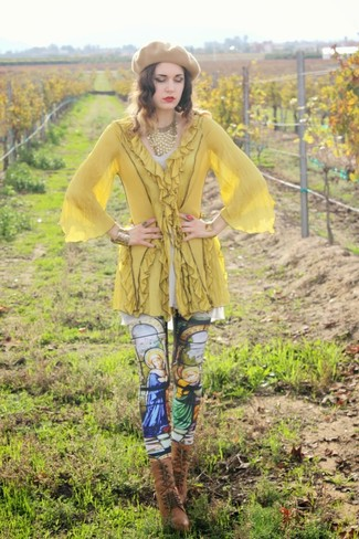 Step up your off-duty look in a yellow tunic and multi colored graphic leggings. Bump up the cool of your ensemble by rounding it off with brown leather lace-up ankle boots. You can bet this ensemble will become your go-to come chillier days.