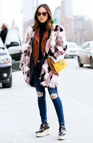 How to wear: navy ripped skinny jeans, black turtleneck, tobacco suede biker jacket, pink fur coat