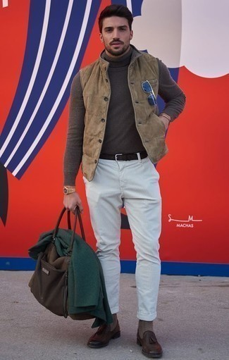 How to Wear a Gold Watch For Men: No matter where the day takes you, you'll be stylishly prepared in this laid-back pairing of a tan suede gilet and a gold watch. You can get a little creative with footwear and add dark brown leather tassel loafers to the equation.