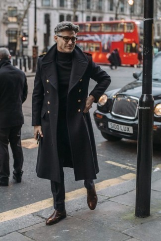 Men's Looks & Outfits: What To Wear In Chill Weather: Teaming a black overcoat and black dress pants is a fail-safe way to infuse your styling routine with some manly elegance. Does this ensemble feel all-too-classic? Let a pair of dark brown leather chelsea boots spice things up.