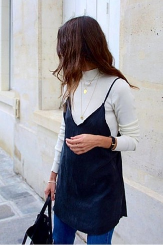 How to wear: white turtleneck, black cami dress, blue jeans, black leather tote bag