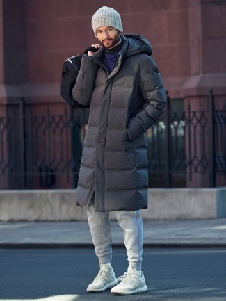 How to wear: grey sweatpants, charcoal turtleneck, navy crew-neck sweater, charcoal puffer coat