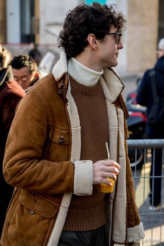 How to wear: black dress pants, white turtleneck, brown knit crew-neck sweater, brown shearling jacket
