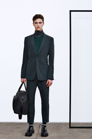 How to wear: black leather derby shoes, charcoal turtleneck, dark green crew-neck sweater, charcoal suit