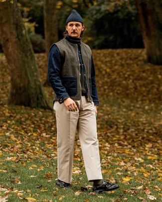How to wear: beige chinos, olive turtleneck, navy denim jacket, charcoal wool gilet