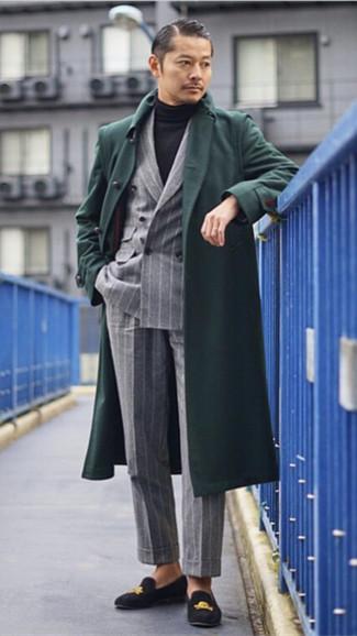 How to wear: grey vertical striped dress pants, black turtleneck, grey vertical striped double breasted blazer, dark green overcoat