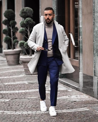How to wear: navy dress pants, grey turtleneck, navy double breasted blazer, grey overcoat